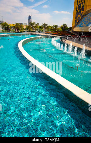 Dubai, UAE - November 28, 2018: Pure turquoise water in the pool with fountains near Dubai Frame. - Stock Photo