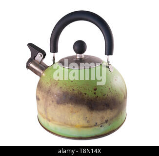 Kettle damaged by fire from a gas stove. Isolated on a white background - Stock Photo