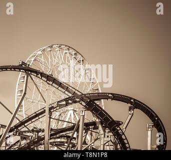roller coaster and ferris wheel - Stock Photo