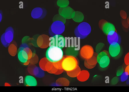 Christmas decorations concept. Defocused light of colorful garland. Festive backdrop with colorful lights. Bright and festive atmosphere of coming holiday. Abstract colorful bokeh background. - Stock Photo
