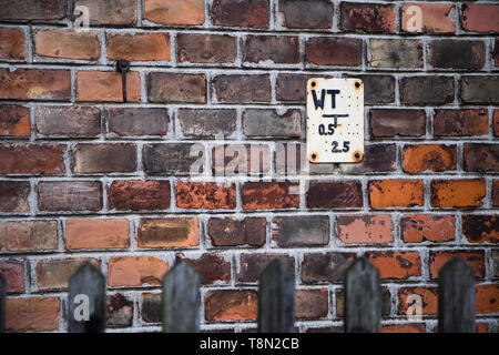 Old red brickwall with wooden fence - Stock Photo