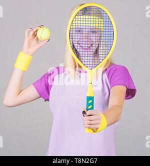 Tennis sport and entertainment. Active leisure and hobby. Girl fit slim blonde play tennis. Sport for maintaining health. Active lifestyle. Woman hold tennis racket in hand. Tennis club concept. - Stock Photo