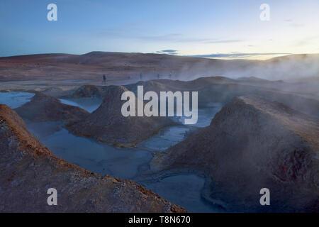 Sol de Mañana geysers steaming at dawn, Salar de Uyuni, Bolivia - Stock Photo