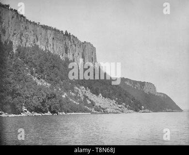 "'Northern End of Palisades, Hudson River', c1897. The Palisades, are a line of steep basalt cliffs along the west side of the lower Hudson River, they appear on the first European map of the New World, made by Gerardus Mercator in 1541.  From ""A Tour Through the New World America"", by Prof. Geo. R. Cromwell. [C. N. Greig & Co., London, c1897] - Stock Photo"
