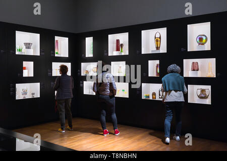 Leopold Museum Vienna, rear view of three women looking at a display of glassware made by Secession era artists J Hoffmann and O Prutscher, Austria. - Stock Photo