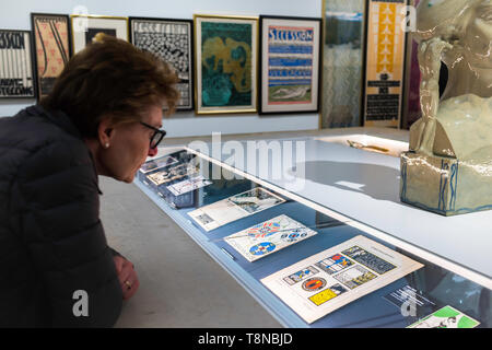 Leopold Museum Vienna, view of a woman looking at a display case containing original commercial artwork by Secession artists in the Leopold Museum. - Stock Photo