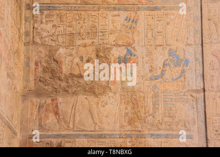 Painting in the court of Ramesses II in the temple of Luxor - Stock Photo