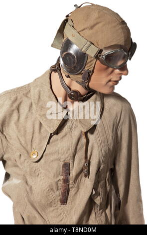 A uniform ensemble for a pilot, summer outfit Summer flight helmet with larynx microphone, aviator goggles with tieback. Summer combination with 'Ri-Ri' zip closures and 'Prym' buttons, arm compass, brown leather belt with aluminium buckle and pistol holster. Lined leather boots with lateral zip closures and heating connections. The uniform is mounted on a movable mannequin with a martial profile. All parts with light signs of wear, mostly with maker or requisition markings. A beautiful ensemble for a typical aviator's summer outfit. historic, historical, Air Force, branch , Editorial-Use-Only - Stock Photo