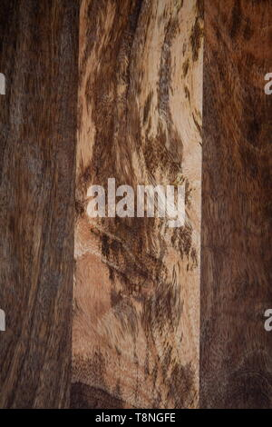 The contrasting pattern of wood on a wooden board from mango tree. The texture of the mango tree - image - Stock Photo