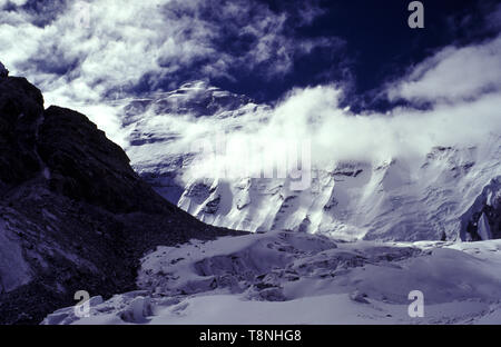 The north face of Mount Everest in Tibet, China. The photograph was taken on approx 6000 meter, in August, 1994. Just left of the upper center is the summit, 8848 m. In the foreground is a part of the Rongbuk glacier. - Stock Photo