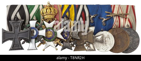 An orders clasp for a flight officer of both World Wars Nine-piece orders clasp with Prussia: Iron Cross 2nd Class of 1914, Saxony: Knight's Cross 1st Class with Swords of the Albert Order, silver-gilt issue by Scharffenberg, Duchy of Saxony: Knight's Cross 1st Class with Swords of the Ernestine House Order in gold (stitched without suspension ring, imperial orb with fissure), Schwarzburg-Sondershausen: Honour Cross 3rd Class with Swords, German Reich: Honour Cross for Front Fighters 1934, Wehrmacht Long Service Awards 2nd and 4th Class with eagle appliqués for Luftwaffe, A, Editorial-Use-Only - Stock Photo