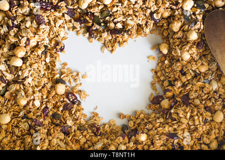 Heart made in home made granola on white background. Healthy breakfast concept copy space. - Stock Photo