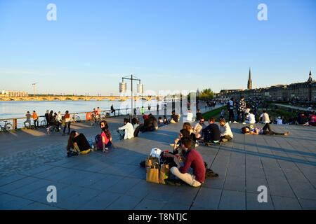 France, Gironde, Bordeaux, area classified as World Heritage, Marechal Lyautey quay, Pont de Pierre on Garonne River and Saint Michel basilica in the  - Stock Photo