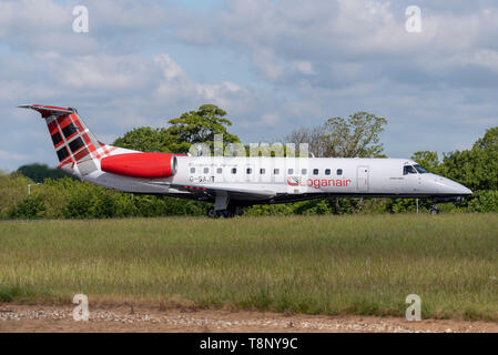 Loganair Embraer ERJ135 airliner at London Southend Airport, Essex, UK. Tartan tail. Lined up for take off - Stock Photo