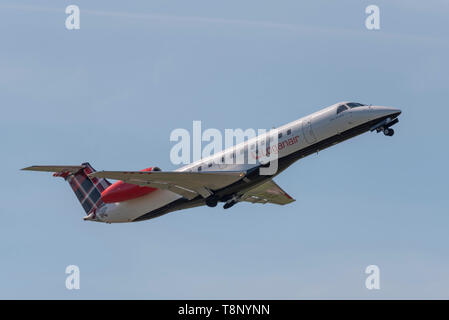 Loganair Embraer ERJ135 climbing out after take off at London Southend Airport, Essex, UK. Climb out. Space for copy - Stock Photo