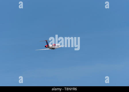 Loganair Embraer ERJ135 climbing out after take off at London Southend Airport, Essex, UK. Climb out. Flying away. Space for copy - Stock Photo