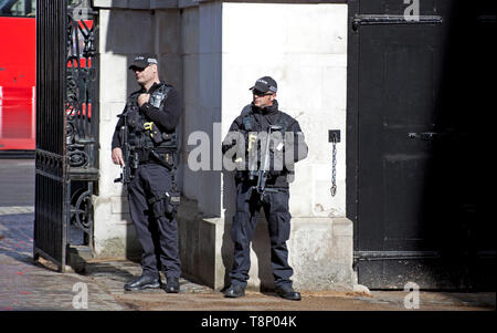 Two Armed Policemen, Horseguards entrance, London, England, UK - Stock Photo
