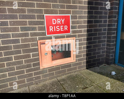 Dry riser inlet at base of multi story car park - Stock Photo