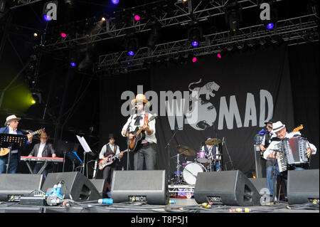 Vinicio Capossela and the La Banda della Posta (The Post Office Band) performing at the Womad Festival, Charlton Park, UK,  England. July 27, 2014 - Stock Photo