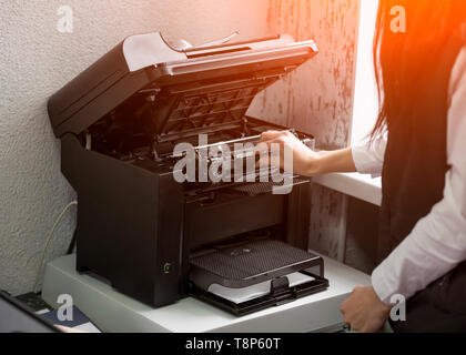 office worker change the cartridge in a laser printer - Stock Photo