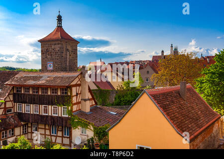 Beautiful panoramic rooftop view of the well preserved middle-age town Rothenburg ob der Tauber in the Franconia region of Bavaria, Germany with the... - Stock Photo