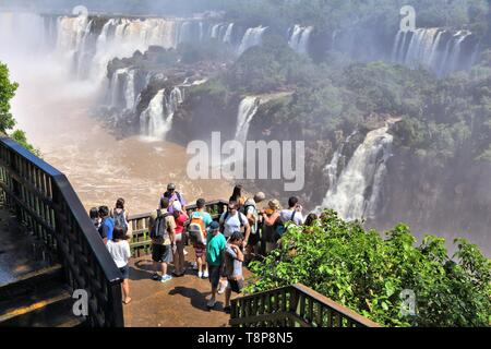 IGUACU NATIONAL PARK, BRAZIL - OCTOBER 9, 2014: People visit Iguacu National Park in Brazil. The park was established in 1939 and is a UNESCO World He - Stock Photo