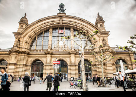 FRANKFURT, GERMANY - APRIL 24, 2019:  View of the central train station, Hauptbahnhof, in Frankfurt am Main, seen for the outside with people visible. - Stock Photo