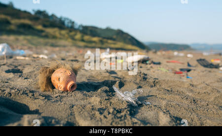 Dirty beach landscape full of waste - Stock Photo