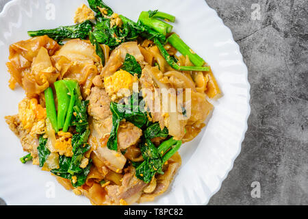 Stir-fried Fresh Rice-flour Noodles With Sliced Pork, Egg and Kale. Quick noodle stir-fry. - Stock Photo