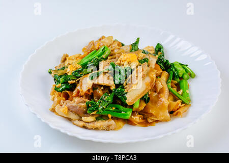 Stir-fried Fresh Rice-flour Noodles With Sliced Pork, Egg and Kale. Quick noodle stir-fry. - Stock Photo