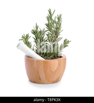 Mortar and pestle with fresh green rosemary on white background - Stock Photo