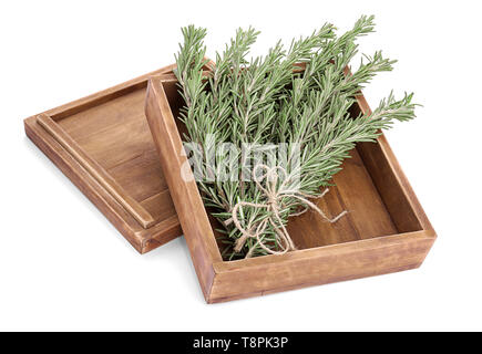 Wooden box with fresh green rosemary on white background - Stock Photo