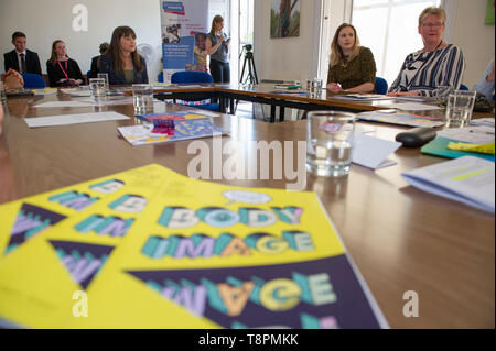 Edinburgh, UK. 14 May 2019. Mental Health Minister, Clare Haughey, joins Girlguiding Scotland members at Girlguiding HQ to discuss the impact of body image on mental health and wellbeing.  Ms Haughey announces the remit of the new Advisory Group on MEntal Body Image, which will identify steps to improve support for young people.  The Minister meets with Girlguides of all ages to discuss their experience of body image and how this can affect their mental health, and about any other pressures that impact them. Credit: Colin Fisher/Alamy Live News. - Stock Photo