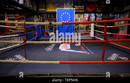 Hamburg, Germany. 14th May, 2019. An election booth with an EU flag is located in the boxing ring 'Zur Ritze' at the Hamburg Reeperbahn. The initiative #SayYesToEurope wants to mobilise for the EU election and offers the possibility to fill in the postal voting documents brought along at special places. Credit: Axel Heimken/dpa/Alamy Live News - Stock Photo