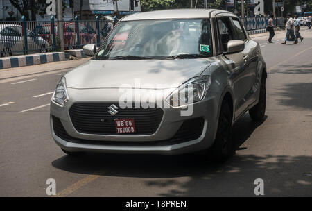 Kolkata, India. 14th May, 2019. A new car is seen in?the street in Kolkata, India, May 14, 2019. India's automobile sector continued its bumpy ride for the fifth consecutive month in April with 20 percent drop in car sales and 16 percent drop in two-wheeler sales, compared with the same period last year. The drastic drop in sales was attributed to several factors including liquidity squeeze in the market, rising fuel cost, interest rates and insurance costs that has dampened consumer sentiment. Credit: Tumpa Mondal/Xinhua/Alamy Live News - Stock Photo