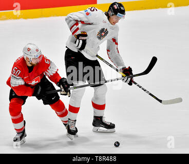Bratislava, Slovakia. 14th May, 2019. L-R TRISTAN SCHERWEY (SUI) and RAPHAEL WOLF (AUT) in action during the match Switzerland against Austria at the 2019 IIHF World Championship in Bratislava, Slovakia, on May 14, 2019. Credit: Vit Simanek/CTK Photo/Alamy Live News - Stock Photo