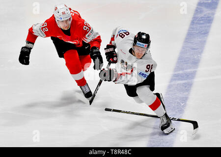 Bratislava, Slovakia. 14th May, 2019. L-R GAETAN HAAS (SUI) and BENJAMIN BAUMGARTNER (AUT) in action during the match Switzerland against Austria at the 2019 IIHF World Championship in Bratislava, Slovakia, on May 14, 2019. Credit: Vit Simanek/CTK Photo/Alamy Live News - Stock Photo