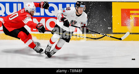 Bratislava, Slovakia. 14th May, 2019. L-R ROMAN JOS (SUI) and BENJAMIN BAUMGARTNER (AUT) in action during the match Switzerland against Austria at the 2019 IIHF World Championship in Bratislava, Slovakia, on May 14, 2019. Credit: Vit Simanek/CTK Photo/Alamy Live News - Stock Photo