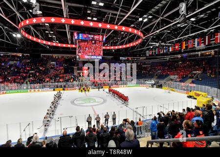 Bratislava, Slovakia. 14th May, 2019. Players listen the Swiss national anthem after the match Switzerland against Austria at the 2019 IIHF World Championship in Bratislava, Slovakia, on May 14, 2019. Credit: Vit Simanek/CTK Photo/Alamy Live News - Stock Photo