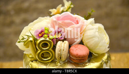 Golden birthday cake with number 18 and roses on the cake , image - Stock Photo