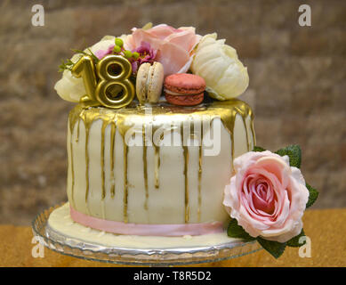 Golden birthday cake with number 18 and roses on the cake , - Stock Photo
