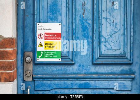 No entry sign on old blue door. Kensington, London, England - Stock Photo