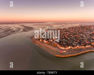 France, Somme, Baie de Somme, Le Crotoy, aerial view of the sunrise over the village of Crotoy and the slikke discovered by the low tide - Stock Photo