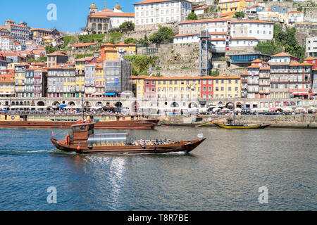 Douro River waterfront in Gaia with Barrio La Ribeira across river and Rabelo Boats. Portugal . - Stock Photo