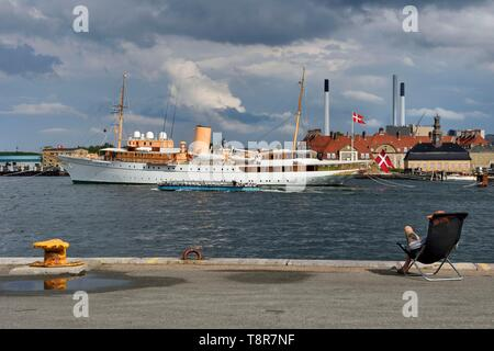 Denmark, Zealand, Copenhagen, port of Copenhagen, le yacht royal KDM Dannebrog, the Holmen Naval Base and Nyholm Central Guardhouse in the background - Stock Photo