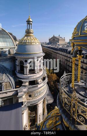 France, Paris, Boulevard Haussman, the gilded dome of the department store Le Printemps Haussmann and the Garnier Opera in the background