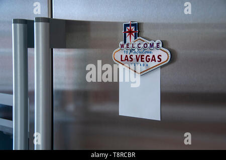 Las Vegas Fridge Magnet with blank notelet attached on a modern stainless steel fridge - Stock Photo