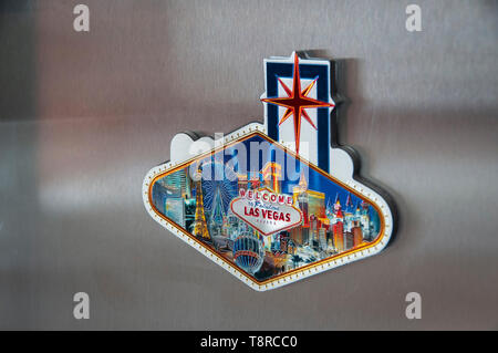 Las Vegas Fridge Magnet attached to a modern stainless steel fridge - Stock Photo