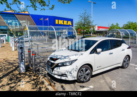 A Nissan LEAF electric car charging at an Ecotricity charging point outside the large IKEA store on the Greenwich Peninsula. - Stock Photo