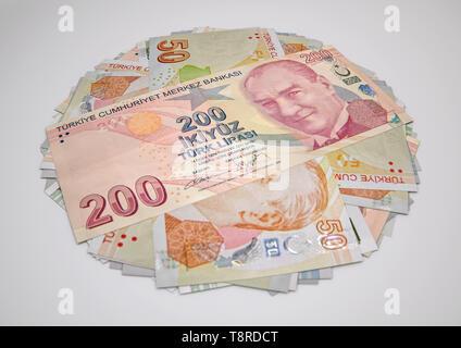 3D Illustration of Various Turkish Lira Banknotes isolated on white background - Stock Photo